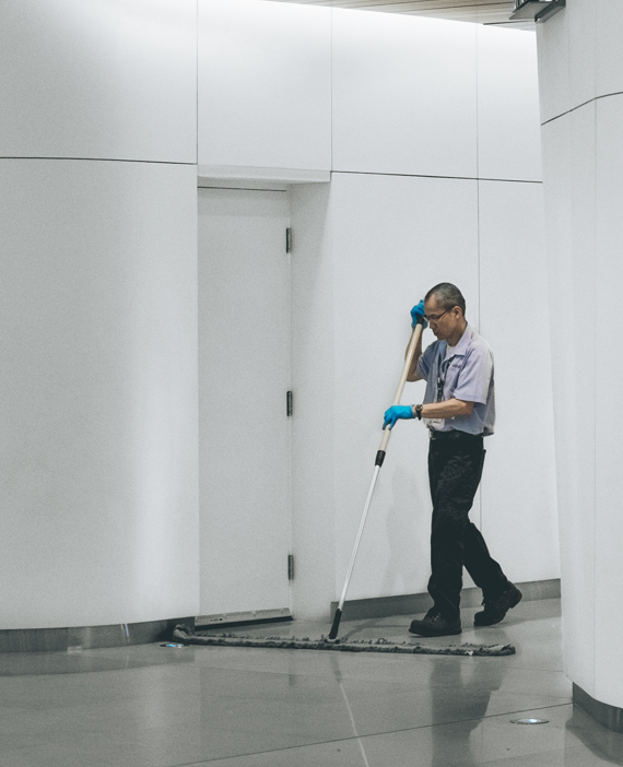 man sweeping floor